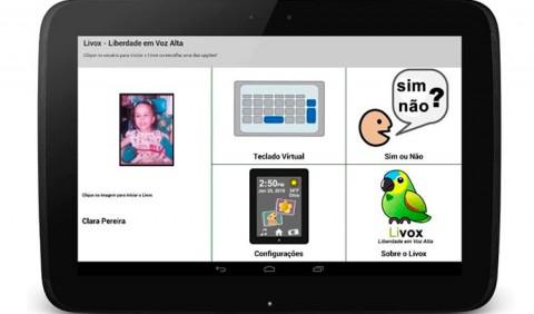 Tela de um tablet com cinco figuras: a foto de uma menininha, um teclado, um bonequinho com as palavras sim e não, uma tela de configurações e um papagaio, o símbolo do Livox