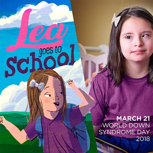 Desenho quadrado. À esquerda, as palavras, no alto, Lea goes to school e o desenho de um menininha embaixo; à direita, a foto de uma garota com Síndrome de Down, usando as mesmas roupas do desenho da criança, e os dizeres embaixo: March 21 World Down Syndrome Day 2018
